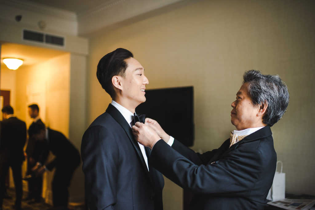 Father helping his son the groom, who just about to get married in Banff at The Fairmont Hotel