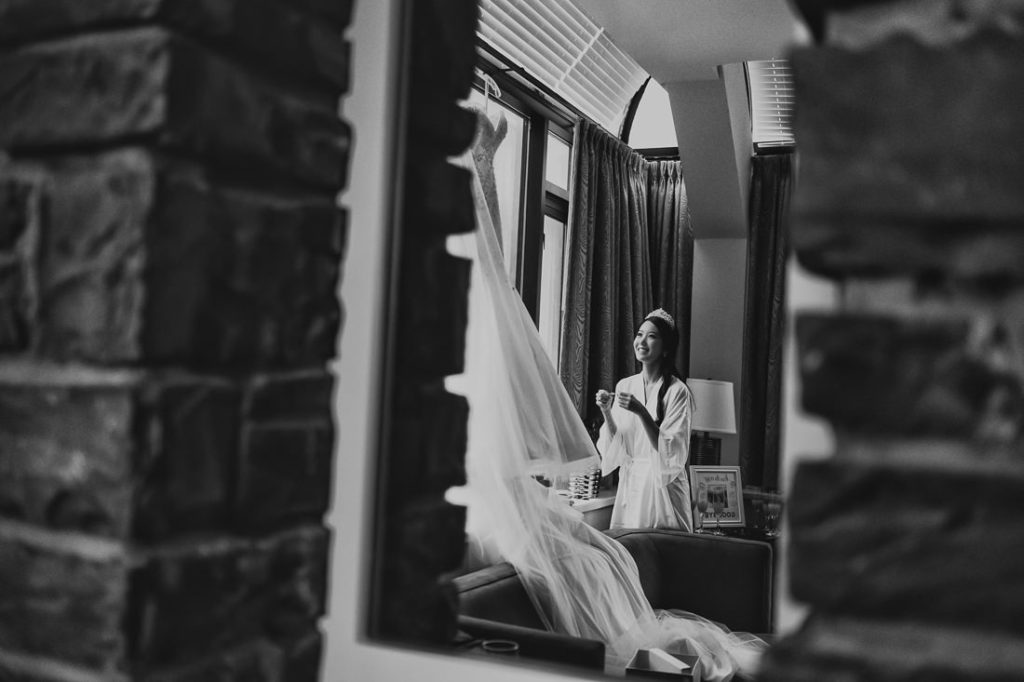 Bride smiling and excited to change into her Luxurious Wedding Gown