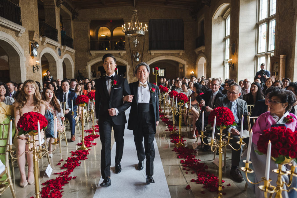 Groom being given away by his dad in a Luxury wedding at Fairmont Banff
