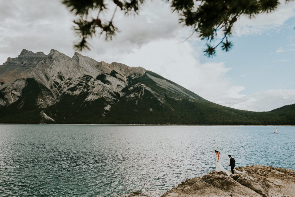 Wedding Couple at Lake Minnewanka  during their Destination Wedding in the Rocky Mountains