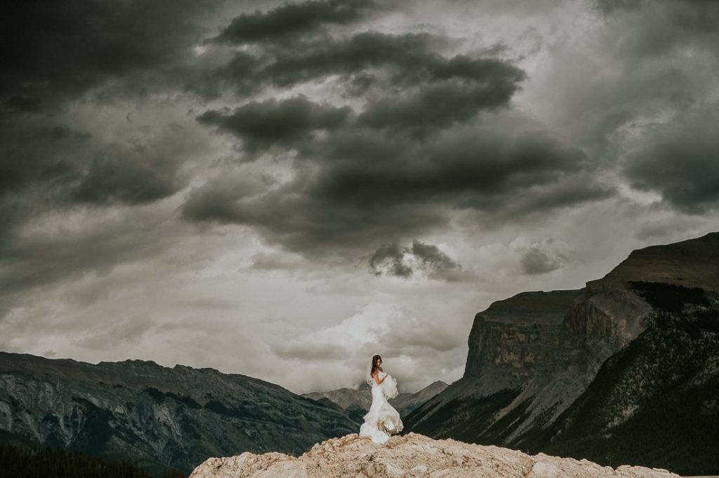 Bride having her photos taken with the Canadian Rockies Breathtaking views
