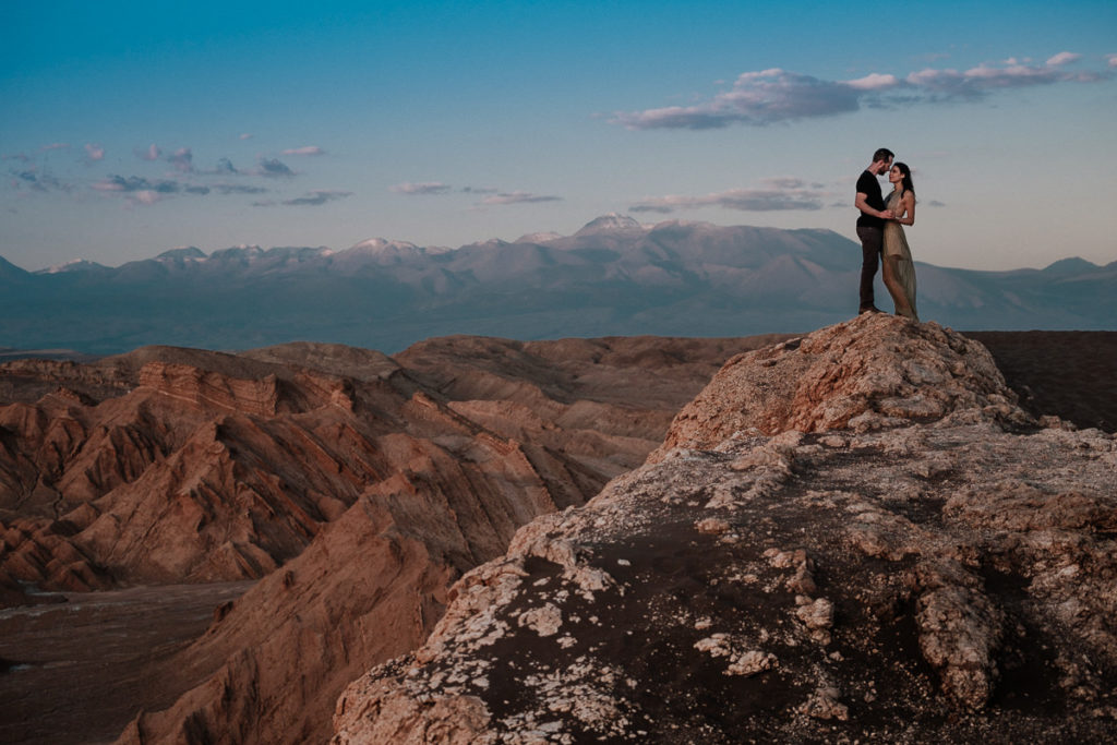 couple posing in the Breathtaking landscape of the Atacama desert in chile