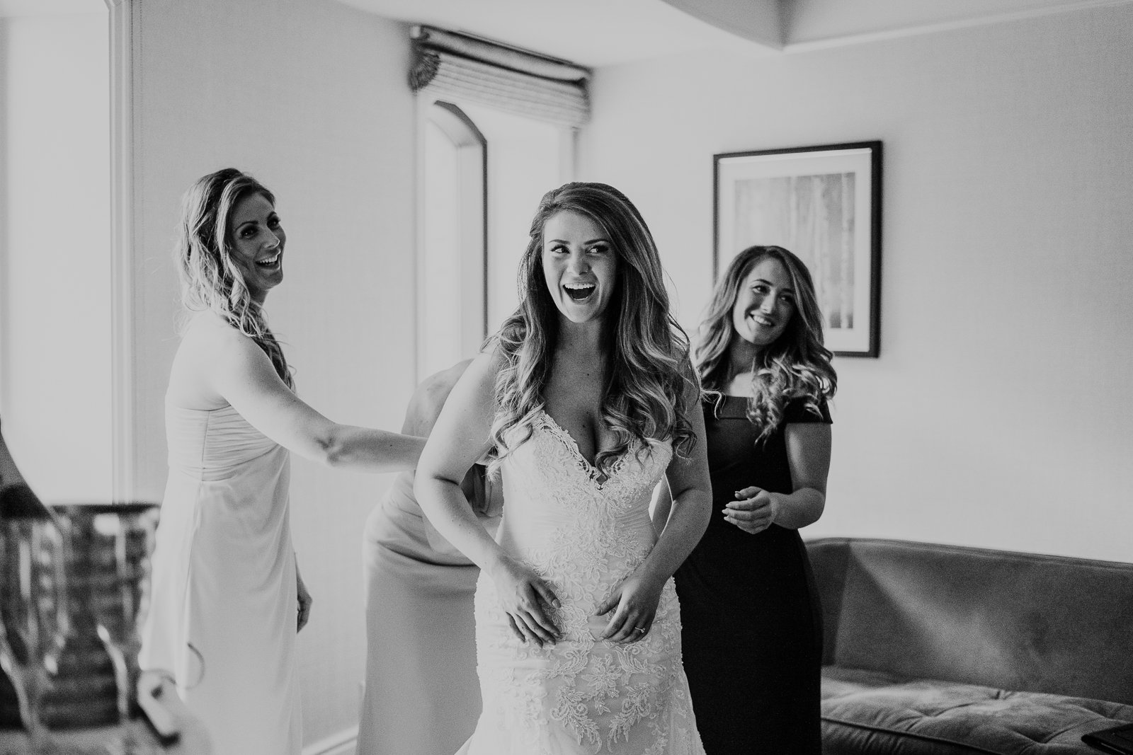 bride getting ready laughing